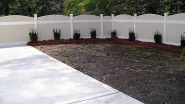 Lakeland Convex Almond and White Vinyl Fence